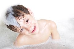Smiling boy having bath Stock Photo