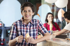 Smiling Boy Having Ice Cream At Parlor Stock Image