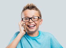 Smiling boy having a phone call Stock Images