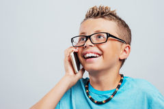 Smiling boy having a phone call Stock Image