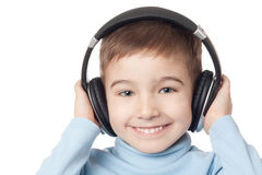 Smiling boy in headphones. Over white background stock image
