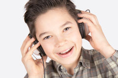 Smiling boy with headphones. Smiling and happy boy with headphones Stock Photography