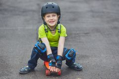 Boy in helmet posing with skateboard Royalty Free Stock Photography