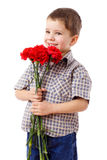 Smiling boy hiding a bouquet. Of red carnations, isolated on white Stock Images
