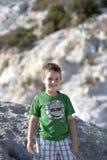 Smiling boy on hillside Stock Photos
