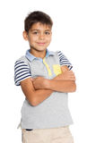 Smiling boy with his arms crossed Stock Image
