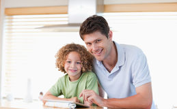 Smiling boy and his father using a tablet computer Royalty Free Stock Images