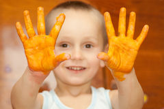 Smiling boy  with his  hands Stock Photo