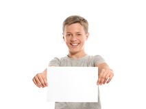 Smiling boy hold white blank paper Stock Images