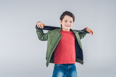 Smiling boy holding baseball bat on shoulders and standing Stock Images