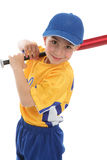 Smiling boy holding a baseball tball bat. A smiling boy with a baseball or t-ball bat and uniform.  White background Royalty Free Stock Photography