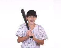 Smiling boy holding bat. Boy smiling holding bat against a white background Royalty Free Stock Photos
