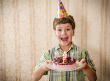Smiling boy holding birthday cake, space for text Stock Image