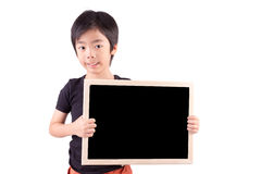 Smiling boy holding a blackboard Royalty Free Stock Photography