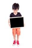 Smiling boy holding a blackboard Royalty Free Stock Photo