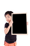 Smiling boy holding a blackboard Royalty Free Stock Images