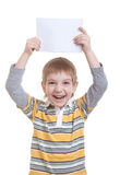 Smiling Boy holding blank sheet of paper Stock Photography