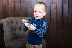 Smiling boy. Holding a camera Royalty Free Stock Photo