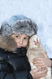 Smiling boy holding a chicken. Royalty Free Stock Photo