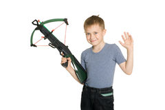 Smiling boy holding a crossbow Stock Photography