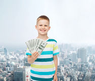 Smiling boy holding dollar cash money in his hand Royalty Free Stock Photos