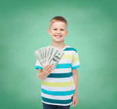 Smiling boy holding dollar cash money in his hand Stock Photography