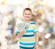 Smiling boy holding dollar cash money in his hand Stock Photo