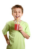 Smiling boy holding fresh fruit juice Royalty Free Stock Photography