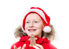 Smiling boy holding gingerbread man. Stock Photo