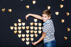Smiling boy holding  golden heart Stock Photo