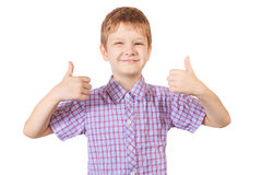 Smiling boy holding his thumb up.  in white. Stock Images