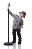 Smiling boy holding a microphone stand Royalty Free Stock Photography