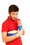 Smiling boy holding popcorn and drinking from cup isolated on wh Royalty Free Stock Photography
