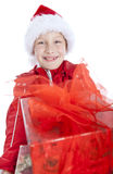 Smiling boy holding present over white. Background Royalty Free Stock Photo