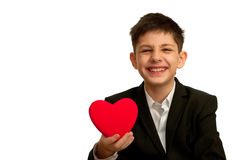 Smiling boy is holding red heart Royalty Free Stock Photography