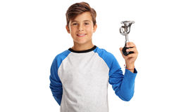 Smiling boy holding a small horn Royalty Free Stock Photo