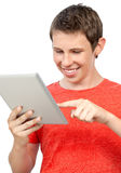Smiling boy holding a tablet stock photography