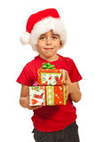 Smiling boy holding Xmas gifts Royalty Free Stock Images