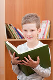 Smiling boy holds big green book Royalty Free Stock Photo