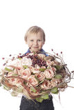 Boy with flowers bouquet Stock Photo