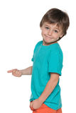 Smiling boy holds his thumb up and back Stock Photo