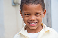 Smiling boy home from school. Portrait of a smiling boy wearing a school uniform in the caribbean - happy to be home from school Stock Photos
