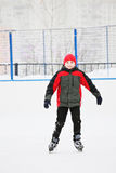Smiling boy on the ice rink Royalty Free Stock Image