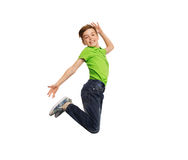 Smiling boy jumping in air Stock Image