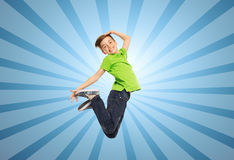 Smiling boy jumping in air Royalty Free Stock Image