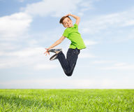 Smiling boy jumping in air Royalty Free Stock Photography