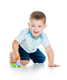 Smiling boy kid playing with toy Stock Photos