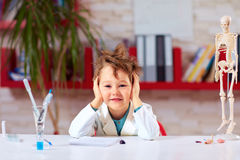 Smiling boy, kid tired after practical lesson in school lab. Education Royalty Free Stock Photo
