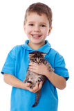 Smiling boy with kitty in hands Royalty Free Stock Photo