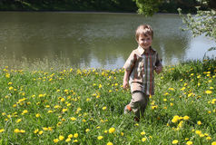 Smiling boy by lake Stock Image